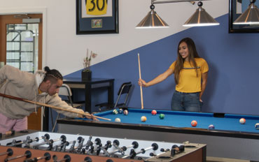 game room with billiards, foosball and ping pong